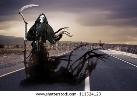 Grim reaper on a road - stock photo