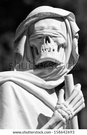 Grim reaper  sculpture on monumental graveyard - stock photo