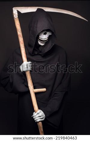 Grim reaper. Studio portrait on black background  - stock photo