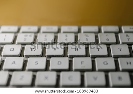 Grimy computer keyboard, focusing on QWERTY keys. - stock photo