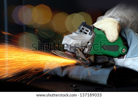 Grinding machine for steel and sparks - stock photo