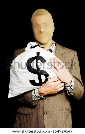Grinning business man hiding under a stocking mask clutches a large money bag from his previous employer conceptual of a business or white-collar thief - stock photo