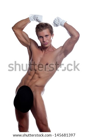 Grinning handsome stripteaser posing in studio - stock photo