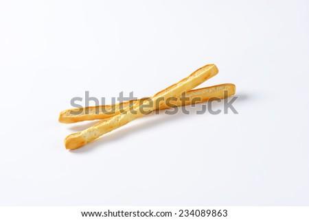 Grissini sticks on white background - stock photo
