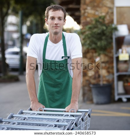 Grocer with Carts in Parking Lot - stock photo