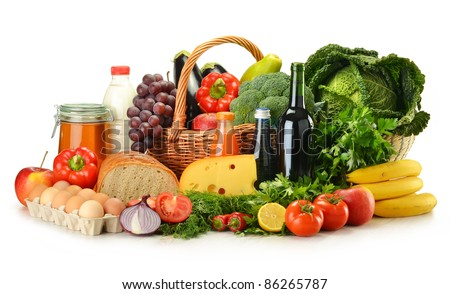 Groceries in wicker basket including vegetables, fruits, bakery and dairy products and wine isolated on white - stock photo