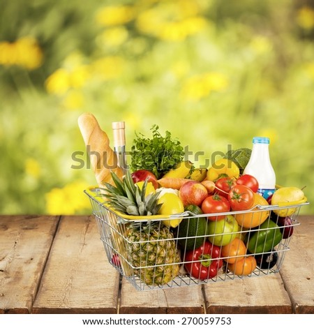 Groceries. Shopping basket - stock photo