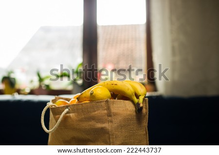 Grocery bag full of fruits. - stock photo