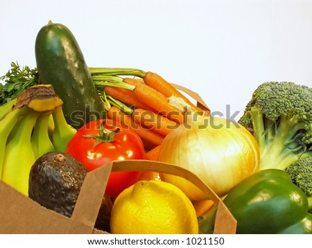 grocery bag with fruits and vegetables - stock photo