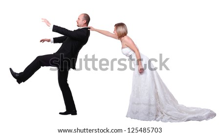 gromm try to escape from wedding - stock photo