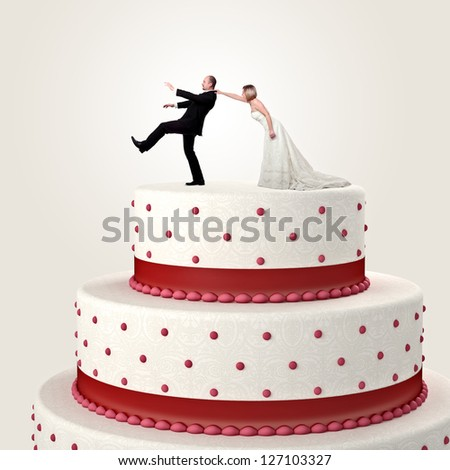gromm try to escape from wedding cake topper - stock photo