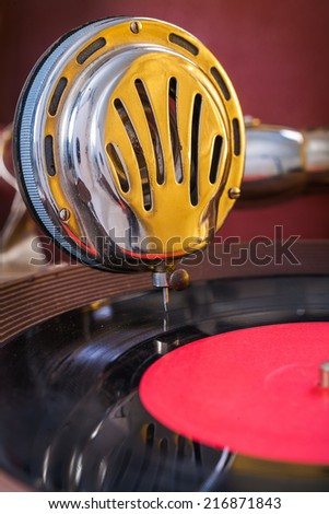 gromophone speaker on vinyl disk close up - stock photo