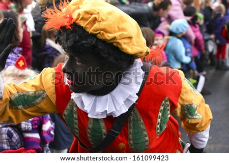 GRONINGEN, NETHERLANDS-NOV 19:Black Piet in close up handing out presents on Nov 19, 2012  The Dutch Sinterklaas feast goes back to the 11th century and is now considered racist by the UN - stock photo