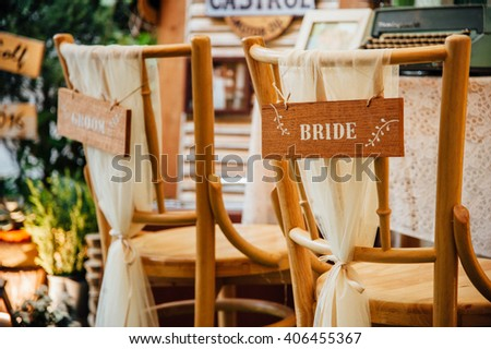groom and bride chairs in wedding ceremony - stock photo