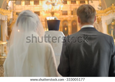 Groom and bride face in church an altar on wedding ceremony - stock photo