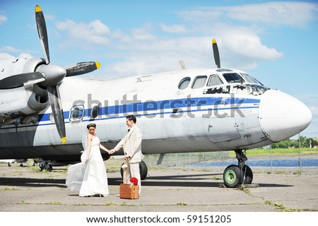 groom and bride fly to wedding travel by  plane - stock photo