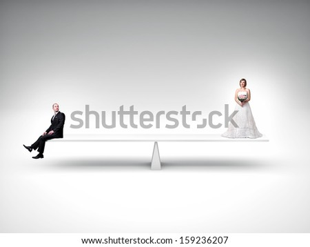 groom and bride in false balance - stock photo