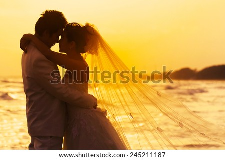 groom and bride in love emotion romantic moment on the beach  - stock photo