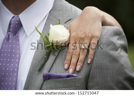 Groom and Bride's Hand with Wedding Ring - stock photo