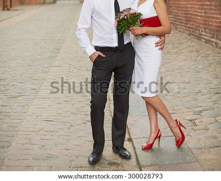 Groom and bride walking together.  - stock photo