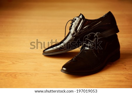 Groom black elegant shoes  - stock photo