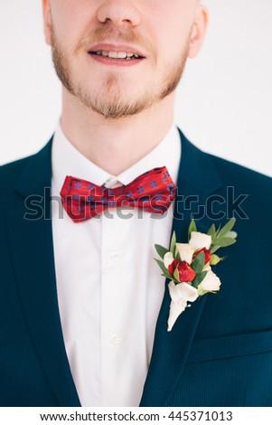 groom buttonhole closeup - stock photo
