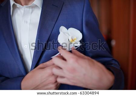 Groom getting flowers - stock photo