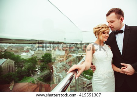 groom holds the hand of his charming woman - stock photo