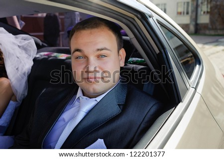 groom in car - stock photo
