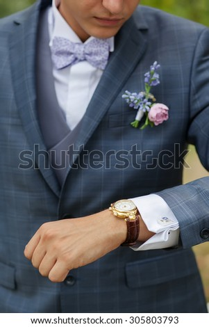 groom in the gray wedding suit at the garden - stock photo