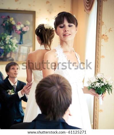 Groom offering his hand to the bride - stock photo