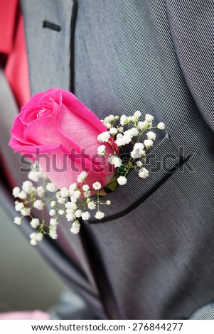 Groom's rose boutonniere - stock photo