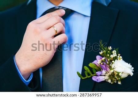 Groom set the tie straight - stock photo