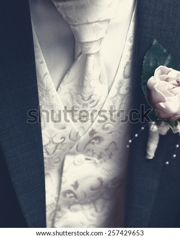 Groom with tuxedo and wedding flower - close-up photo - stock photo