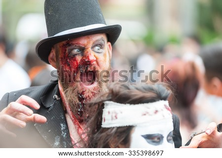 Groom zombie scares at Sydney Zombie Walk in Sydney, AU, 31st October, 2015. Zombie Walk is an annual event where thousands of people get involved to raise awareness for Australia's Brain Foundation. - stock photo