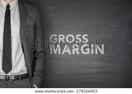 Gross margin on black blackboard with businessman - stock photo