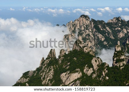 Grotesque Rocks on foggy Mt. Huangshan, Anhui Province - stock photo