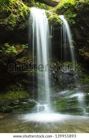 Grotto Falls is a 25 foot waterfall in Great Smoky Mountain National Park, Tennessee, USA - stock photo