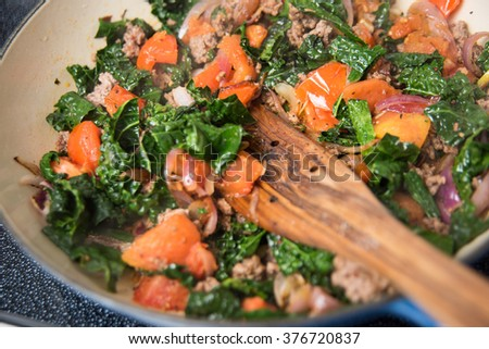 Ground Beef Cooked with Tuscan Kale, Tomatoes, and Red Onions - stock photo