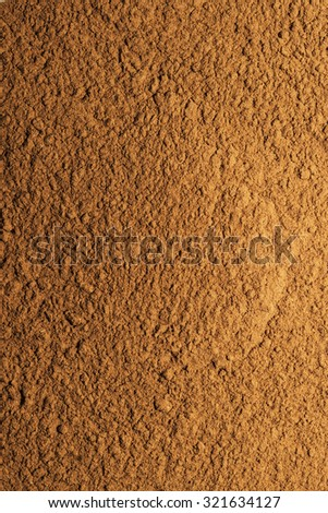 ground cinnamon grouped together to form a background - stock photo