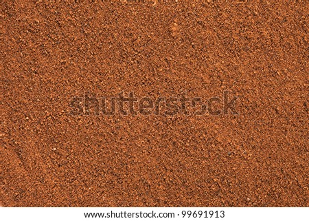 Ground Cinnamon texture, full frame background.  As a spice or condiment cinnamon sold in the form of sticks or a hammer. Used as a spice in cuisines all over the world. - stock photo