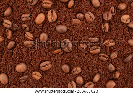 Ground coffee and coffee beans background. Texture of natural coffee - stock photo