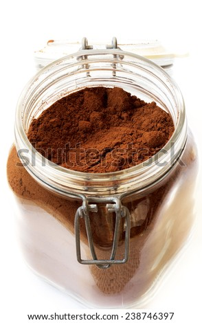 Ground coffee in a glass jar - stock photo