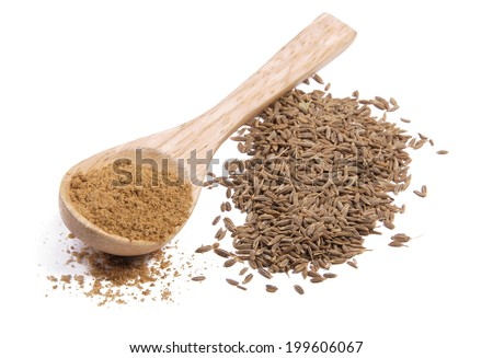 Ground cumin in a spoon and whole cumin - stock photo