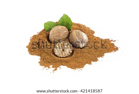 Ground nutmeg and whole nutmeg with green leaves isolated - stock photo
