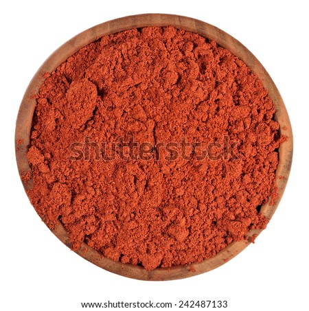 Ground paprika in a wooden bowl on a white background - stock photo