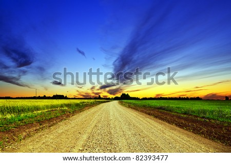 Ground road and sunset sky. - stock photo