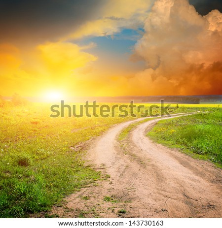 ground road in the green field - stock photo