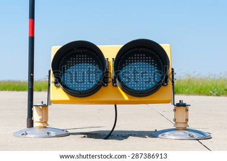Ground side lamp taxiway at the airport. - stock photo