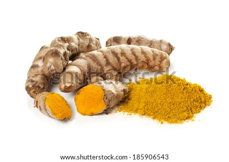Ground turmeric and turmeric roots isolated on white background - stock photo